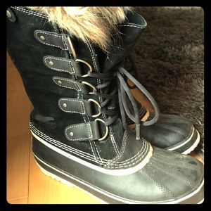 Sorel tall winter boots with fur.